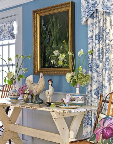 White picnic table w/ blue & white toile curtains + white beadboard