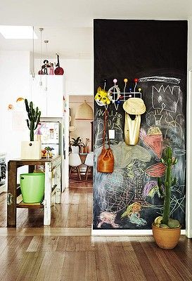 The home of Madeleine and Karl Stamer. The chalkboard wall in the open-plan kitchen and lounge room provides a creative space for Ada and Wilhelmina. Styling by Heather Nette King, Photography by Armelle Habib for The Age, Sunday Life.