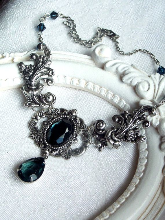 This necklace/choker was made of montana blue faceted glass stone in antique silver frame, decorated by ornaments.  Theese victorian ornaments