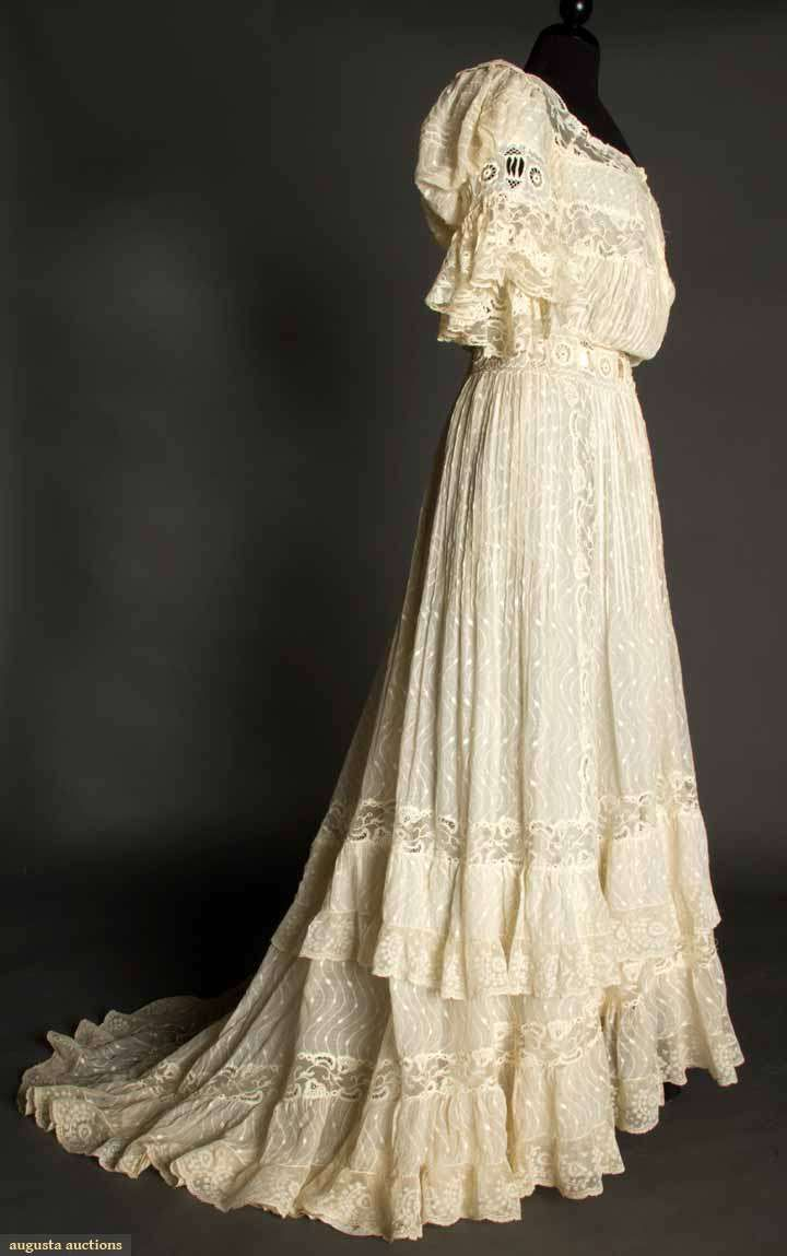 IVORY LAWN & LACE TEAGOWN, c. 1905 Pin-tucked cotton woven w/ serpentine-dot pattern, embroidered lace inserts at waist & short sleeves, Val lace trim, trained skirt, ivory China silk lining. Sideway