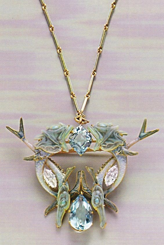 An Art Nouveau 'Fish' pendant, by René Lalique, 1904-06. Composed of gold, enamel, diamonds and aquamarines.