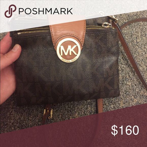 Purse Had for 2 year. Some of the embroidering fell off on the strap, but besides that in good condition KORS Michael Kors Bags Crossbody Bags