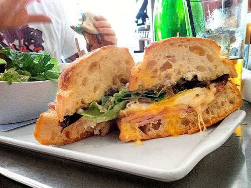 Ham and Raclette Panino Lula Cafe  A crusty ciabatta bun is a flavorsome sponge for oozing Swiss cheese, rich egg yolk, and mustard with sweet-and-sour bursts of black currant. Smoky cured ham seals the deal.