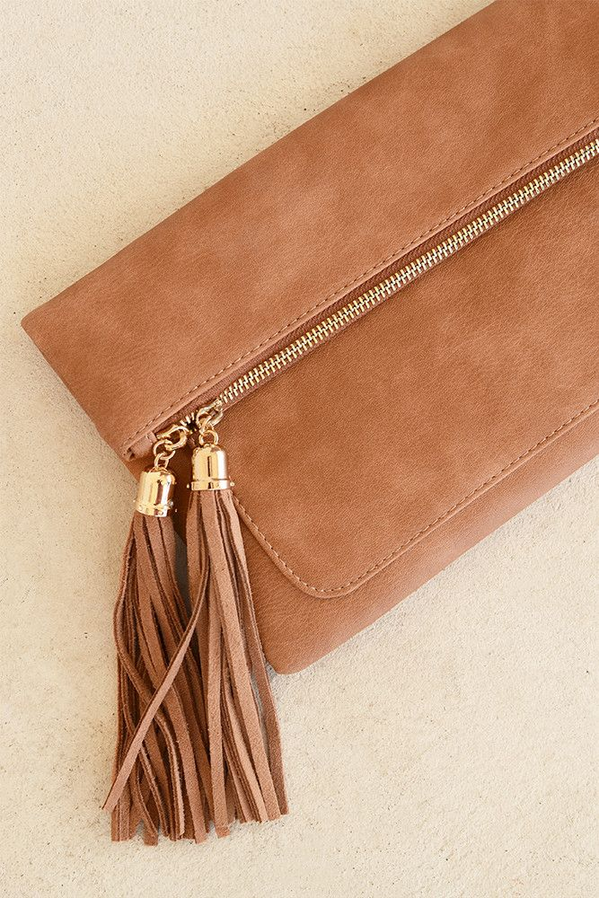 This chic, brown faux leather tassel clutch is one you definitely need as a…
