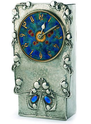 ^Archibald Knox Tudric Clock^   |  (from Liberty's 2005 sale) *Liberty & Co* Tudric mantle clock in pewter, copper and enamel. Designed by Archibald Knox. Model 0608. Circa 1902.   |  Picture by ~lynetter~  May 22 2005