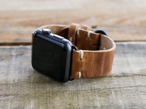 **PLEASE NOTE: This listing is for the apple watch band only, watch not included.**  This handmade Apple watch band features Horween English Tan Leather and a minimal stitch style. Each Apple watch band kit comes with the Horween leather strap, 2 Apple watch adapters and a pentalobe screwdriver. We match the hardware to the watch color as ordered. All watch bands in our shop are handmade to order.   Apple Watch Band Width -  Bands are sized to fit either 38mm or 42mm Apple watch bands…