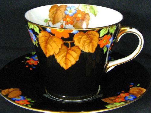 AYNSLEY ART DECO BLACK HP FLORAL TEA CUP AND SAUCER