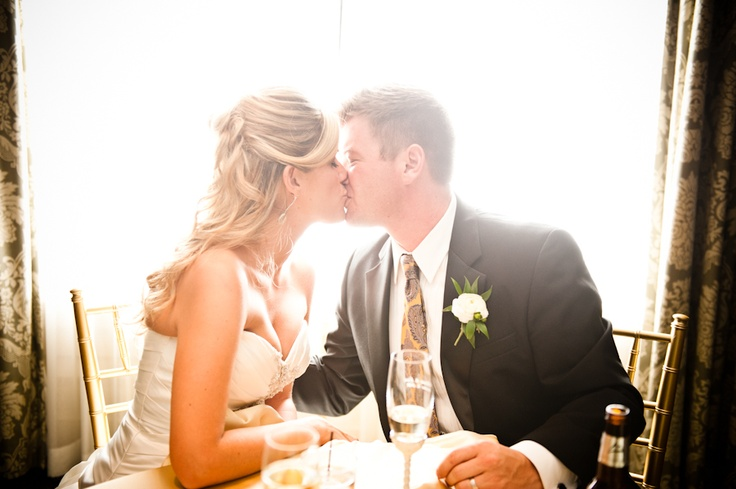 Couples Kiss At Head Table