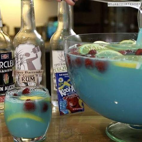 Blue Kool-Aid Jungle Juice #tipsybartender #cocktails #drinks #koolaid #tequila #juice #rum #raspberry