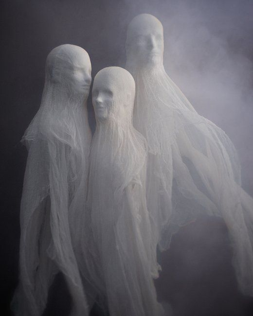 DIY Halloween decoration idea :: Ghosts made from styrofoam heads and cheeseclothes