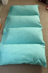 sleeping mat made from pillowcases, just sew together and insert the pillows! too cute.