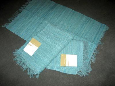 Make a big rug by sewing a few small rugs together!!  Great idea!!  and your pocket will be happy!!!