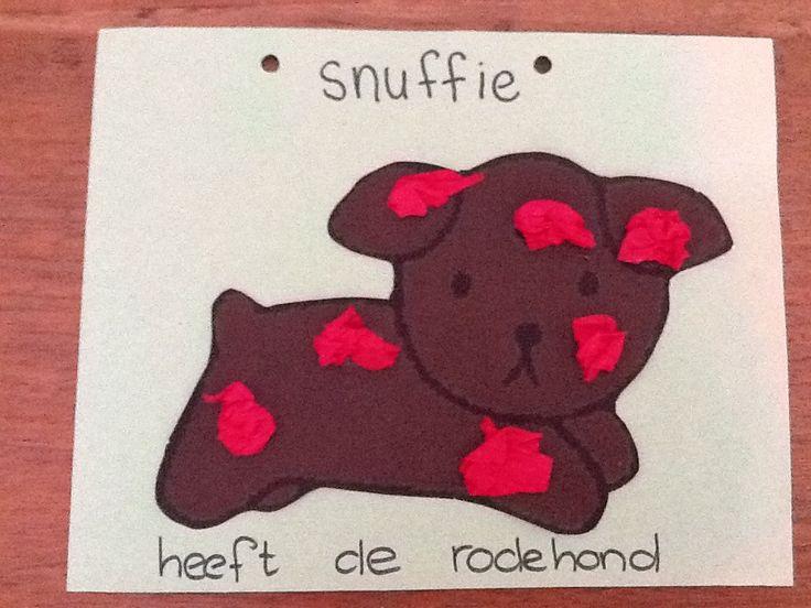 Snuffie heeft de rode hond. De kleinste kinderen plakken er rode propjes op.