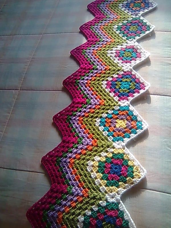 Connect your grannies at the corners and add an edge (works in the other direction too!). I have got to try this one!!