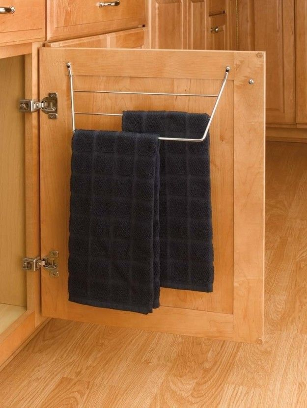 Store towels on a rack inside your cabinets so that they're always at hand.   47 Storage Ideas That Will Organize Your Entire House