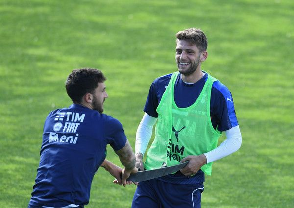 Domenico Berardi of Italy (R) in action during the training session at the club's training ground at Coverciano on April 11, 2017 in Florence, Italy.