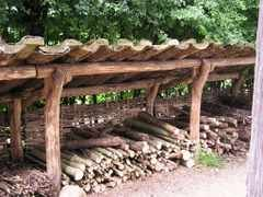 The mono-pitch shed roof to this firewood shed keeps the rain off and