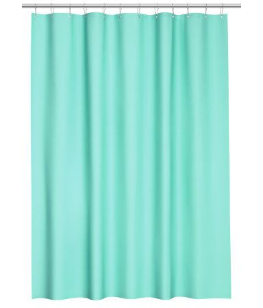Shower curtain in water-repellent polyester with metal eyelets at top. Curtain rings sold separately.
