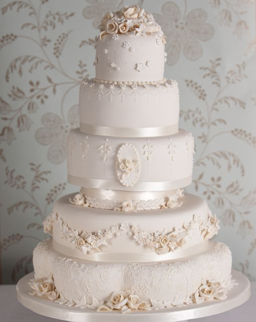 Pretty vintage style pink wedding cake  [Fiona Cairns]