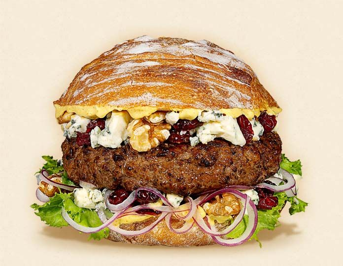 The Waldorf:  Wisconsin Blue Cheese Cheeseburger Recipe.  Other ingredients:  toasted walnuts, curly endive, Dijon mustard, beef patty, dried tart cherries, sliced red onions, and rustic Italian roll.   - Wisconsin Milk Marketing Board