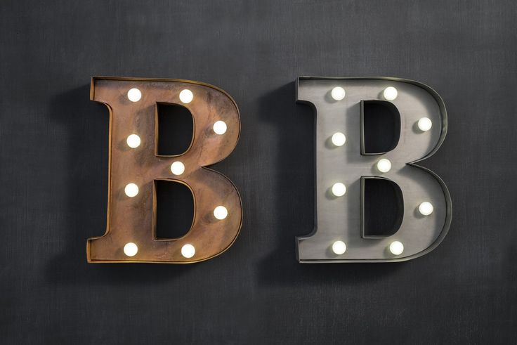 Marquee light letter 'B' in bronze or zinc metal finish. Requires 2 AA batteries.