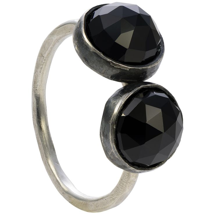 "Two velvet black spinels adorn this simple but powerful gemstone ring. The rose cut stones are a substantial size and they reflect light on their triangular facets. The side-by-side stones look classy, simple and out of the ordinary.  This unique gemstone design doubles the visual impact. The faceted cabochons perfectly wrap around the finger, reinforcing a sense of confidence and aspiration. You can wear the ring with a matching necklace from the ""Two"" collection."