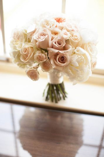 Blush and ivory bouquet featuring sahara roses, pale pink and white peonies, pale pink majolica spray roses (www.redpoppyfloral.com)