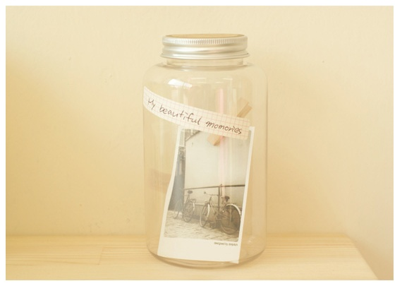 nice idea: storing photos in a large jar :)