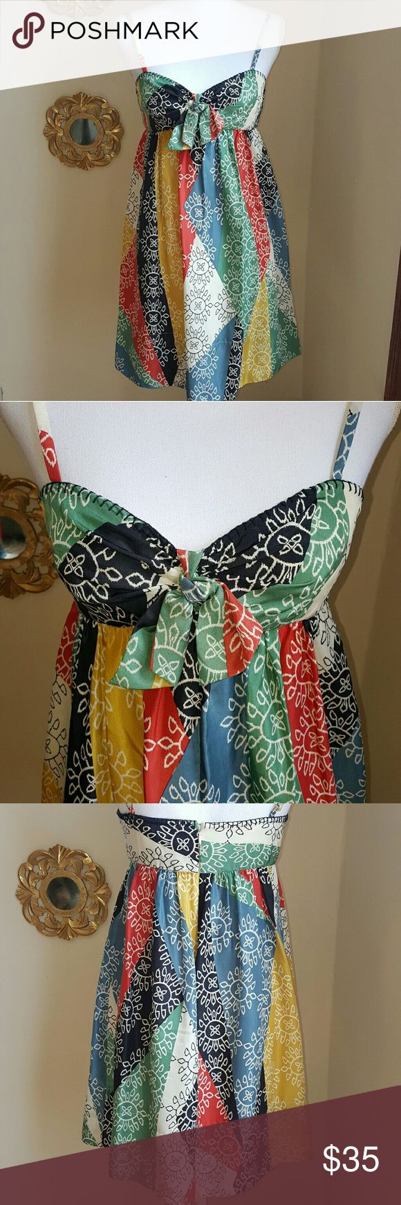 ⬇️ BCBGMaxAzria Colorful Print Silk Dress Beautiful colorful silk dress from BCBG Max Azria that's perfect for Spring & Summer. Pretty stich details along the top and a tie bow in the front. No defects or signs of wear. BCBGMaxAzria Dresses