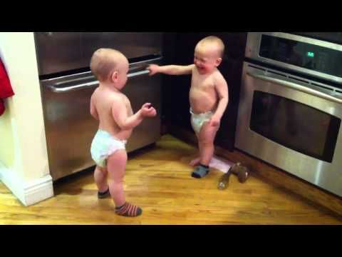 The talking twins... they're arguing about their socks. This is too cute!