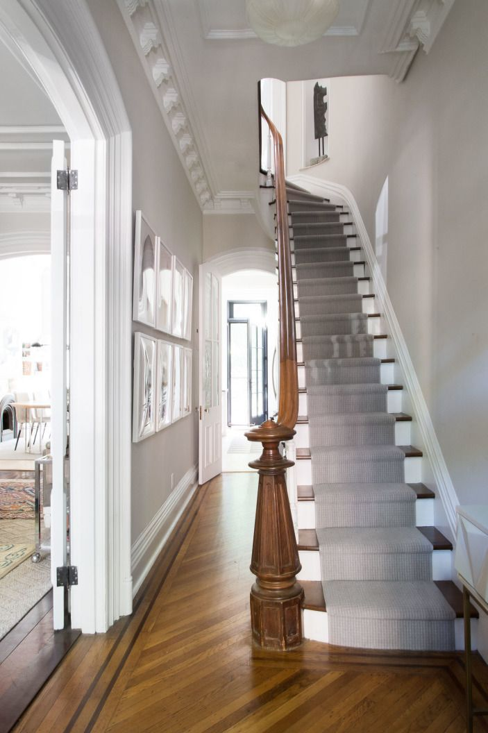 Walking into Homepolish designer Louisa Roeder's landmarked 1870 Brooklyn brownstone, one is struck by the stunning grand staircase. Though she felt guilty about adding paint, it gave levity to the otherwise dark space. Crown moldings and the stair treads were painted, and a runner was added as well.