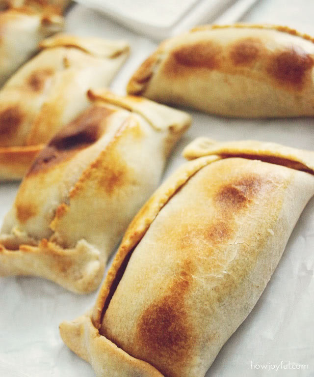 Empanada - National dish of Chile. Baked or fried pastry filled with ground beef, onions, raisins, olives, egg, cheese or seafood.