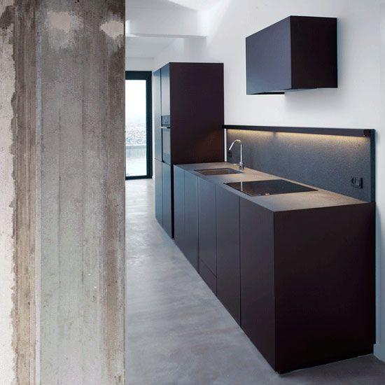 Custom made kitchen in jet black granite by Holgaard Architects.