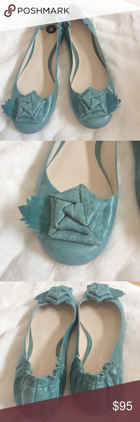 Neiman Marcus | Vero Cuoio Flats Ballet style flats by La Fenice purchased at Neiman Marcus. Antique style leather (robins egg blue color) with a flower at the toe. Scrunched back, comfortable! New without box no flaws. Neiman Marcus Shoes Flats & Loafers