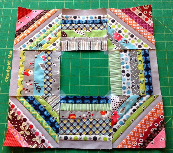 This would be a good drier sheet scrap quilt with a pieced block in the center