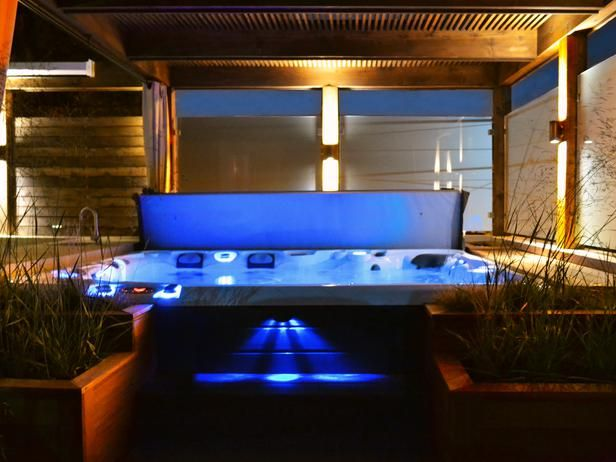 outdoor hot tub lighting. this outdoor space features a hot tub, modern pergola with privacy glass, tropical hardwood tub lighting \