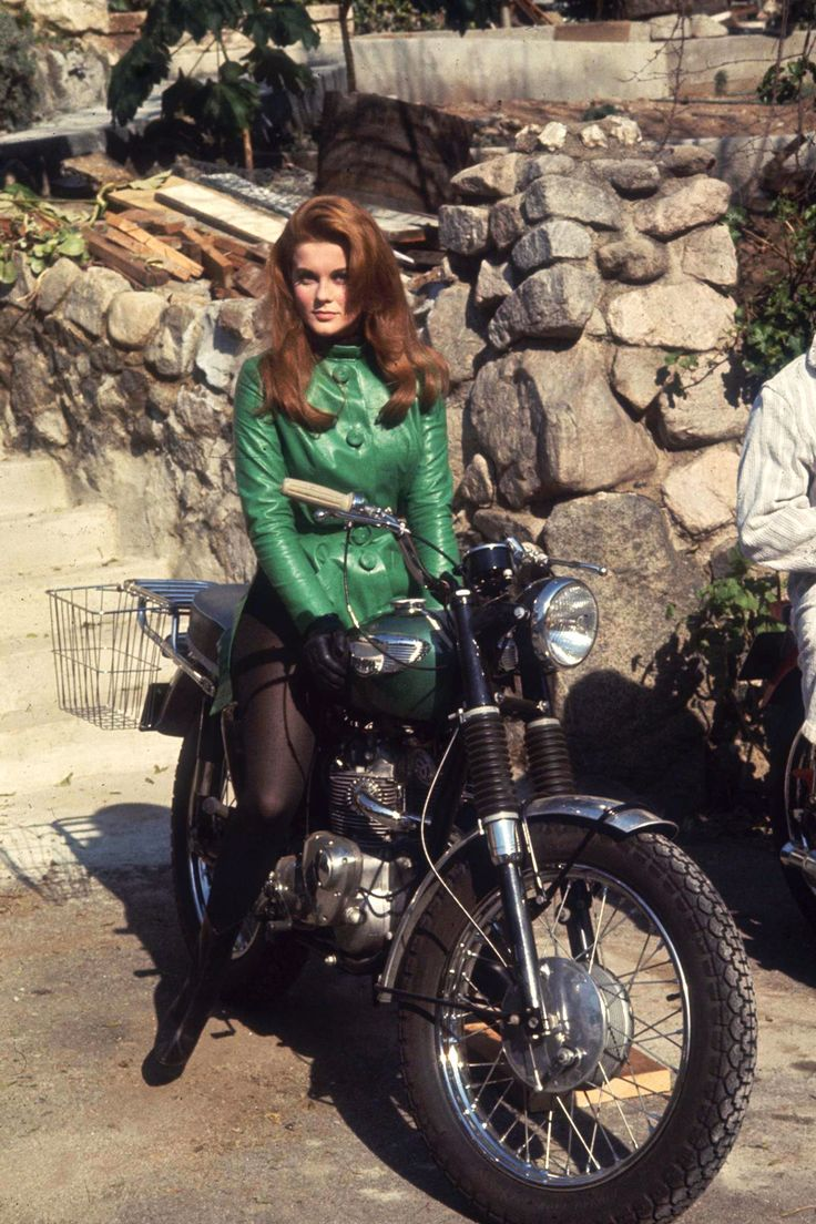 """Ann-Margret straddling a motorcycle """"Ann-Margret: real-life motorbike enthusiast and rider in a production still from The Swinger(1966). """" View Post"""