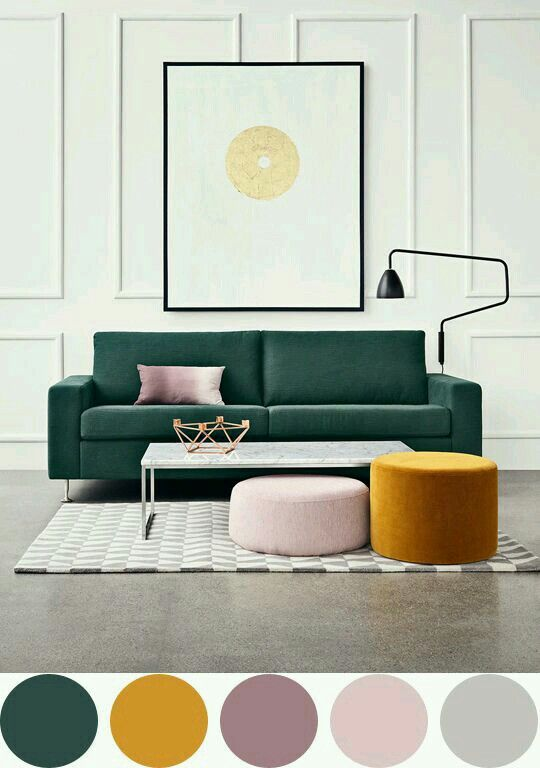 I first saw the green couch. The second thing I saw was thebold ottoman. Last, I was drawn to the abstract lamp.