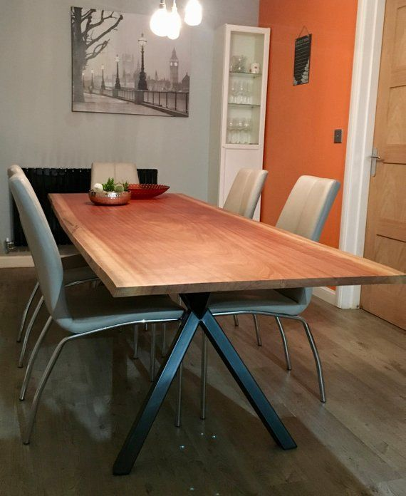 A Large Modern Dining Table Mounted On Stunning Contemporary Legs