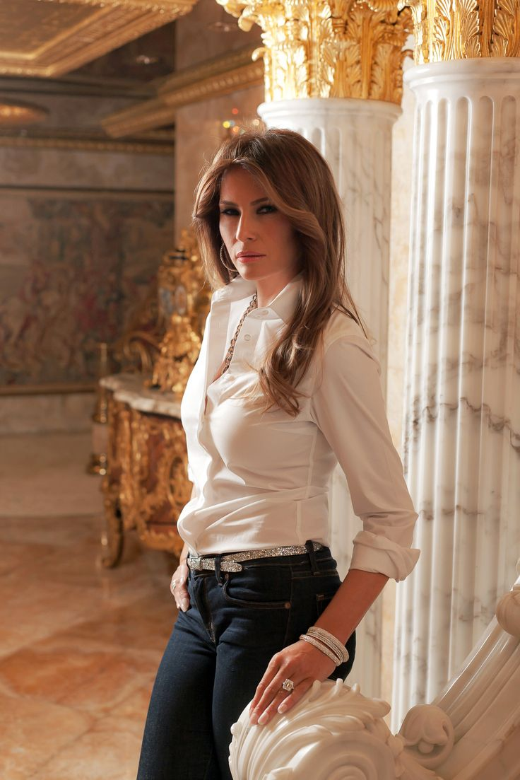 Melania Trump. Classic white blouse and denim. Can't forget the jeweled finishing touches