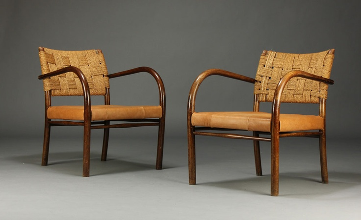 Frits Schlegel. Pair of armchairs of stained beechwood, back with cane, seat later upholstered in leather. Designed in 1930. Produced by Fritz Hansen.