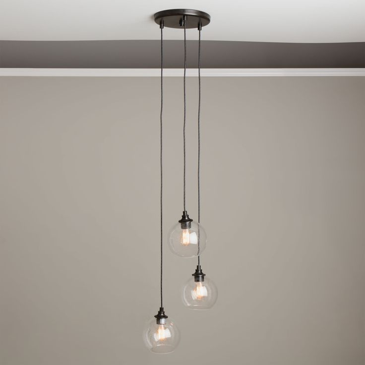 Create a metro-modern look in your home with the addition of this Uptown 3-light cluster pendant. Three unique lights are artfully suspended at various heights with clear globe shades housing unique Edison-style bulbs for a timeless design.