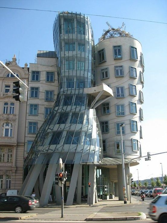 """Dancing Building:  The Dancing House or """"Fred and Ginger"""" is situated in Prague, Czech Republic. This is an amazing masterpiece of architecture, which has its own romantic charm. There is something so sweet in the way the buildings hug each other for a dance! It was designed by Vlado Milunic in cooperation with Frank Gehry, it is a stylish and amazing building, which became a symbol of the city!"""