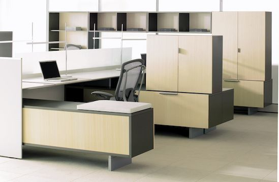 Teknion District Furniture. The stacking, storage, varied heights of components give this system the feel of home office furniture.