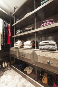 This photo shows a walk-in wardrobe one of our interior designer created for a client of our s based in Kensington.  It was designed to exactly fit that client's wardrobe of clothes and shoes and built by the designer's joiners to her specification.