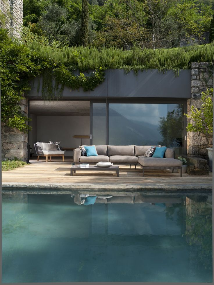 pool and seating area with plants