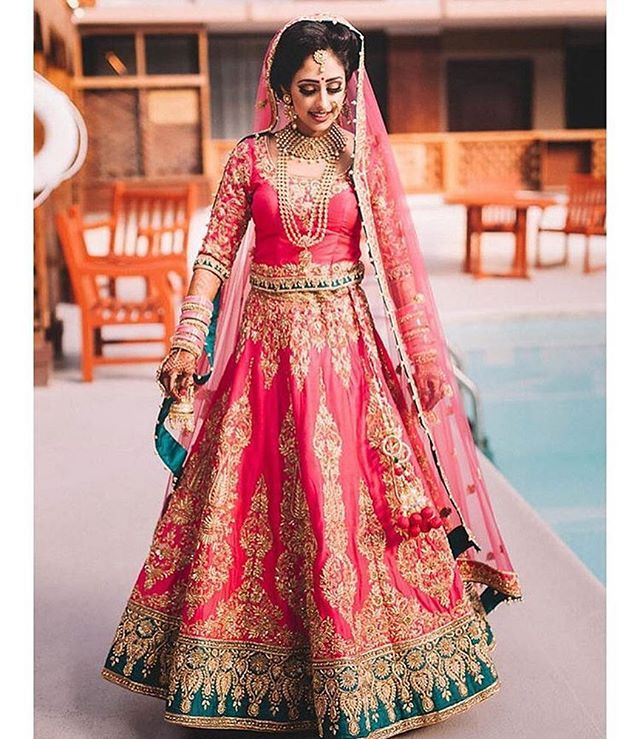 Here's an image of our gorgeous Bay Area, California client Raman in her custom designed Bridal Lehenga! Her outfit was a hot pink raw silk lengha with intricate zardozi embroidery highlighted with topaz Swarovski crystals! Raman came into our Fremont store with a vision in mind and we worked hard to make that come true. Thank you Raman for being such a pleasure to work with we wish you all the best. ❤️
