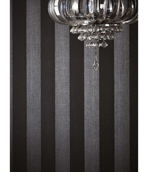 This Teramo Stripe Wallpaper by Arthouse is infused with shimmering silver glitter particles that alternates with a matte black stripe that has a lightly textured fabric effect finish. Free UK delivery available.