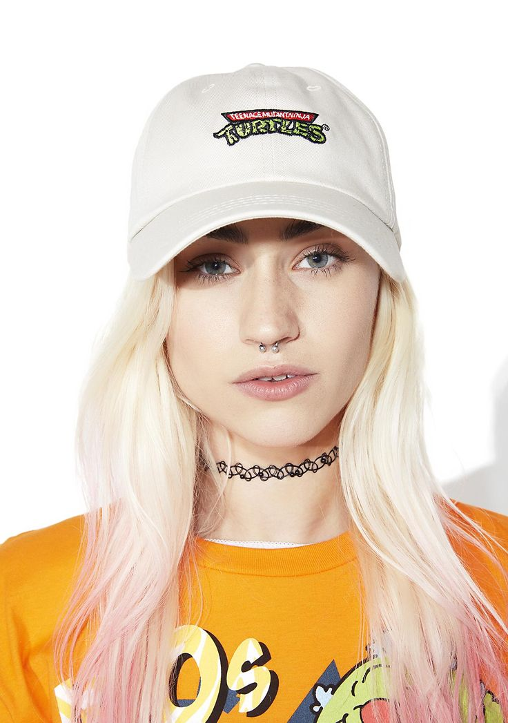 CRSHR Ninja Turtle Hat cowabunga, BB~!! Grab yr samurai swords 'N a slice of 'za and get ready to storm the streets in this sikk dad hat, featurin' a slouchy grey construction, curved brim, adjustable back strap, and a nostalgic logo across the front.