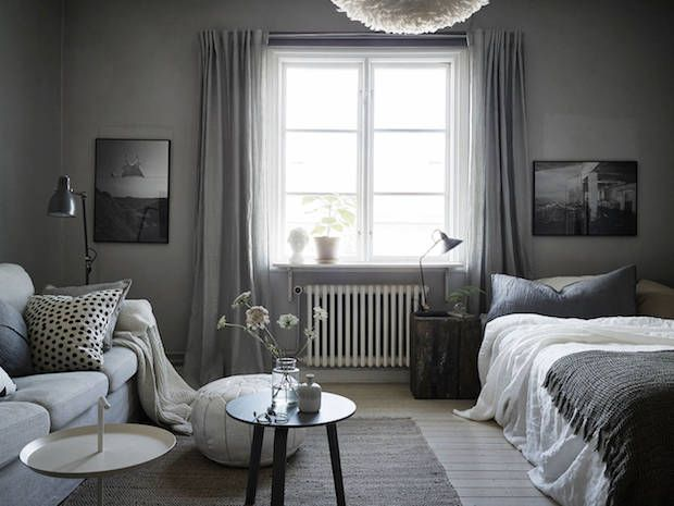 A calm, cocoon-like Swedish space in greys